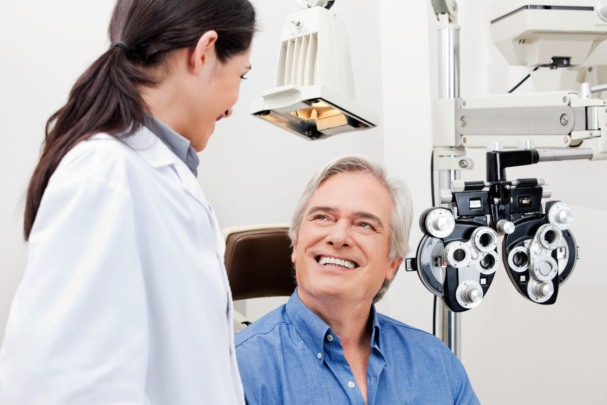 stem-cells-cure-cataracts-eye-exam-optometrist-and-smiling-elderly-man